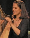 Mia singing and playing Celtic harp at the Irish Arts Center